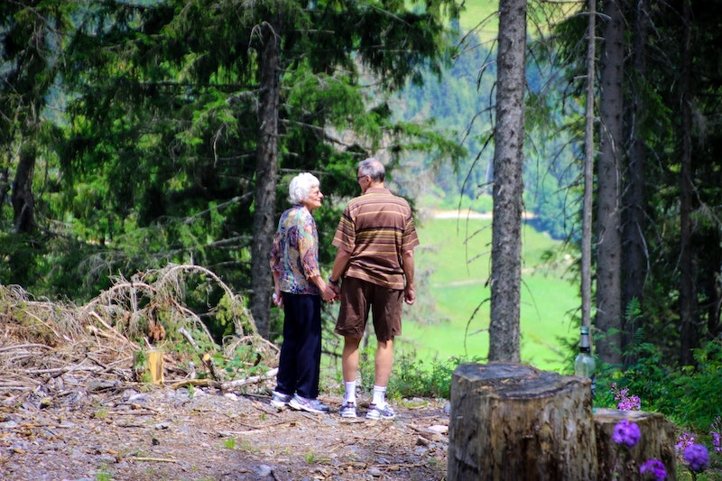 two seniors walking together